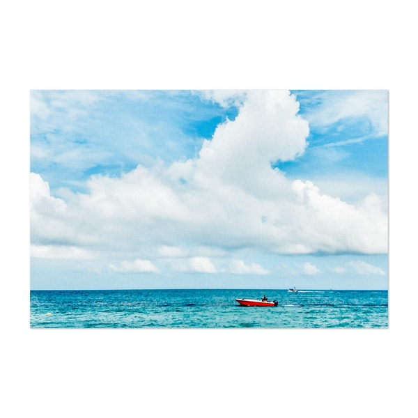 A Red Boat on the Ocean by Sidecar Photo