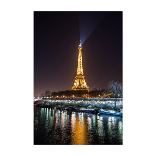 Portrait view of The Eiffel Tower by night by Christos Karydis