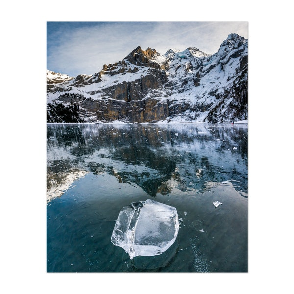 beaufiful clear chunk of ice on frozen lake Oeschinensee with reflection by Marcel Gross